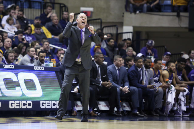 TCU coach Jamie Dixon reacts to a play during the first half of the team's NCAA college basketball game against West Virginia on Tuesday, Jan. 14, 2020, in Morgantown, W.Va. (AP Photo/Kathleen Batten)