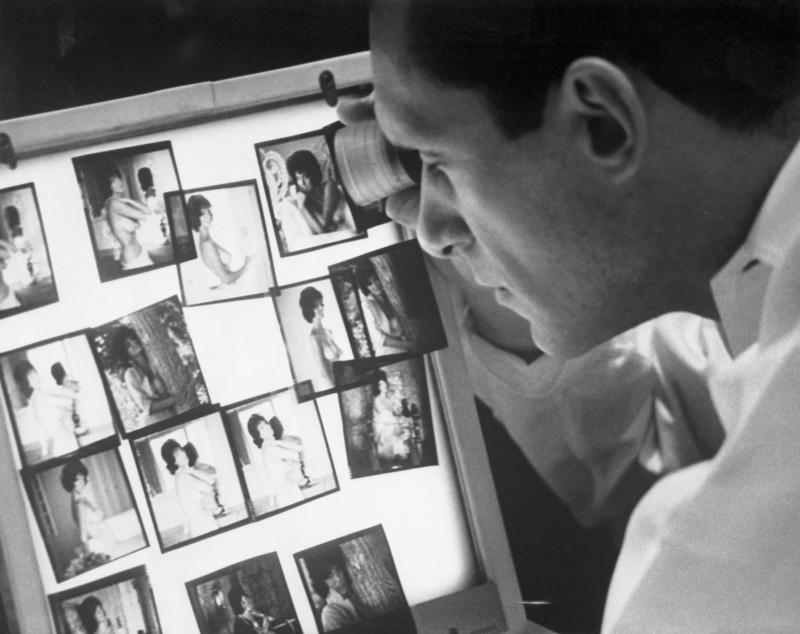 Hugh Hefner viewing photographs in his Chicago office. (Bettmann via Getty Images)