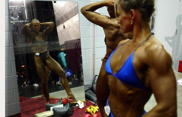 "<div class=""caption-credit""> Photo by: Michael Bradley/Getty Images</div><div class=""caption-title""></div>After thousands of hours at the gym and meticulously crafted nutrition plans, the final step for female bodybuilders poised for competition is product. Lots of it. Popular standards of beauty vary by era, geography, and culture, but in the world of women's muscle mass, there's one hard and fast rule."