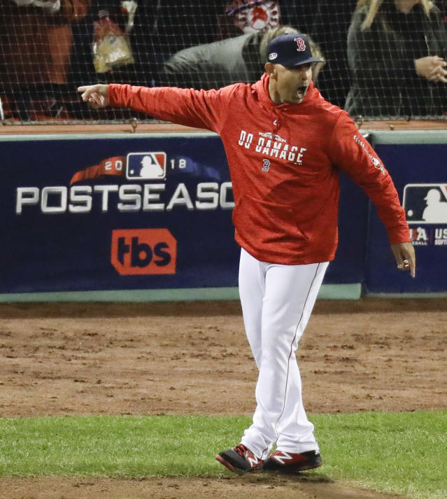 Boston Red Sox manager Alex Cora argues a strike three call during the fifth inning in Game 1 of a baseball American League Championship Series against the Houston Astros on Saturday, Oct. 13, 2018, in Boston. (AP Photo/Elise Amendola)