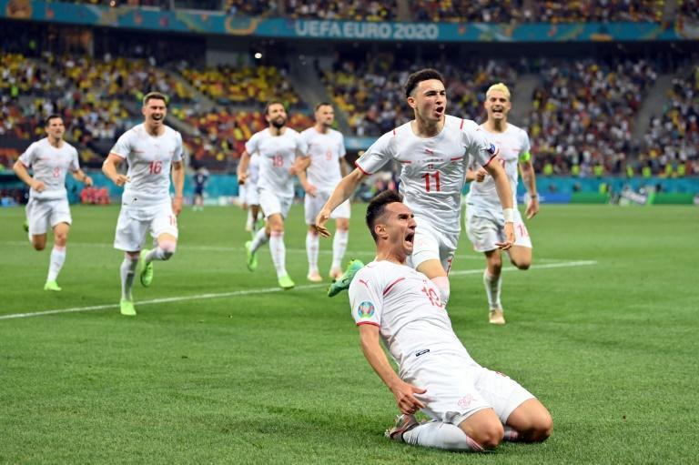 Mario Gavranovic celebrates his late equaliser that forced extra time against France