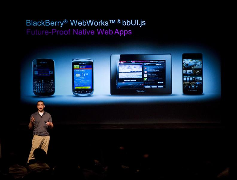 Tim Neil, Research In Motion Ltd.'s Canadian Operating Director of Operations, Platforms and Tools, speaks about the Blackberry 10 architecture during the RIM Blackberry 10 Jam World Tour in Toronto on Thursday June 21, 2012. The first BlackBerry device running RIM's new operating software will not have a physical keyboard, only a touch-screen one. RIM is expected to start selling BlackBerry 10 touch-screen devices this year. (AP Photo/The Canadian Press, Aaron Vincent Elkaim)