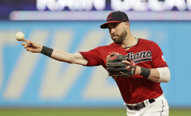 Cleveland Indians' Jason Kipnis throws out Kansas City Royals' Humberto Arteaga at first base in the seventh inning of a baseball game, Saturday, July 20, 2019, in Cleveland. (AP Photo/Tony Dejak)