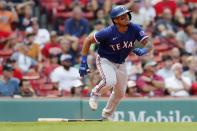 Texas Rangers' Andy Ibanez watches his ground-rule double that drove in two runs during the ninth inning of a baseball game against the Boston Red Sox, Monday, Aug. 23, 2021, in Boston. (AP Photo/Michael Dwyer)