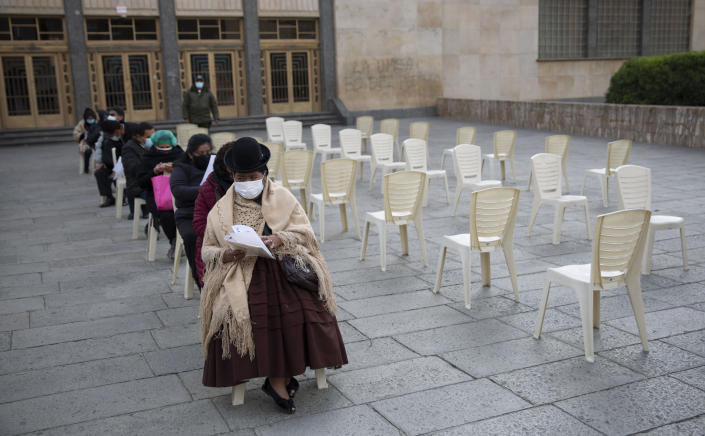People wait their turn for a shot of the Sinopharm COVID-19 vaccine inside the Universidad Mayor de San Andres public university during vaccinations for people over age 50 in La Paz, Bolivia, Monday, May 17, 2021. (AP Photo/Juan Karita)