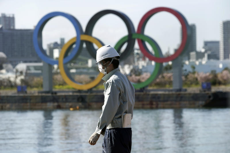 Organizers are moving forward with the Tokyo Olympics as coronavirus fears persist. (AP Photo/Eugene Hoshiko)