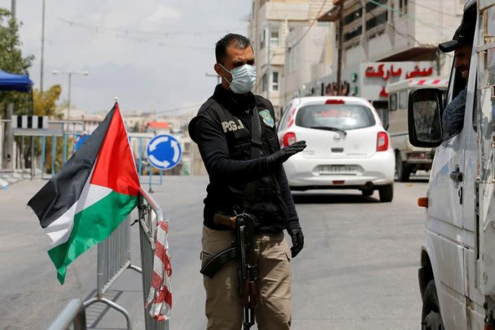 FILE PHOTO: Palestinians extend the coronavirus state of emergency to June 5, in the Israeli-occupeid West Bank