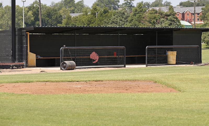 This photo shows an empty dugout on the baseball field at East Central University in Ada, Okla., Wednesday, Aug. 21, 2013. Australian Christopher Lane, who was on a baseball scholarship at East Central University was in Duncan, Okla., visiting his girlfriend, when he was shot and killed. (AP Photo/Sue Ogrocki)