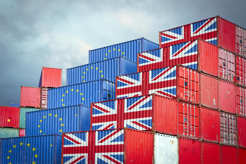 Cargo containers with European Union and British flags