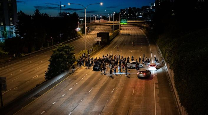 "<span class=""caption"">When blocking a highway, who is a domestic terrorist and who is a peaceful protester? And does it make a legal difference?</span> <span class=""attribution""><a class=""link rapid-noclick-resp"" href=""https://www.gettyimages.com/detail/news-photo/protesters-block-interstate-5-after-marching-from-the-area-news-photo/1222748902"" rel=""nofollow noopener"" target=""_blank"" data-ylk=""slk:David Ryder/Getty Images"">David Ryder/Getty Images</a></span>"