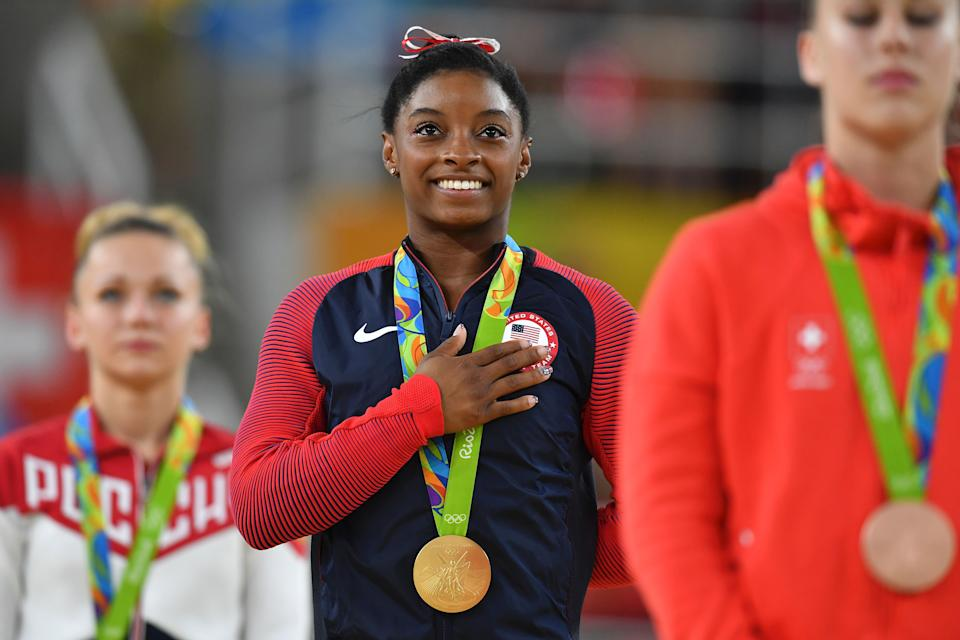 US gymnast Simone Biles (pictured middle) celebrates on the podium for the women's vault event final of the Rio 2016 Olympic Games.