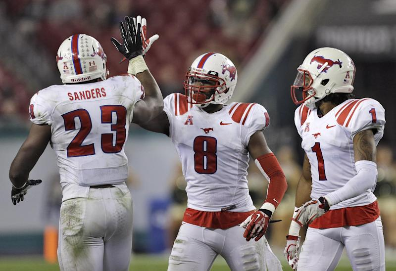 SMU defensive back Jay Scott (8) celebrates with teammates Stephon Sanders (23) and Chris Parks (1) after intercepting a pass by South Florida quarterback Mike White during the fourth quarter of an NCAA college football game Saturday, Nov. 23, 2013, in Tampa, Fla. SMU won the game 16-6