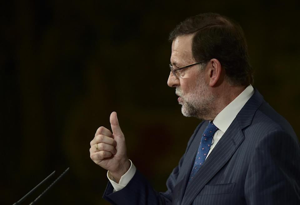 Spanish PM Mariano Rajoy gives a press conference at Moncloa palace in Madrid on August 1, 2014 (AFP Photo/Pierre-Philippe Marcou)