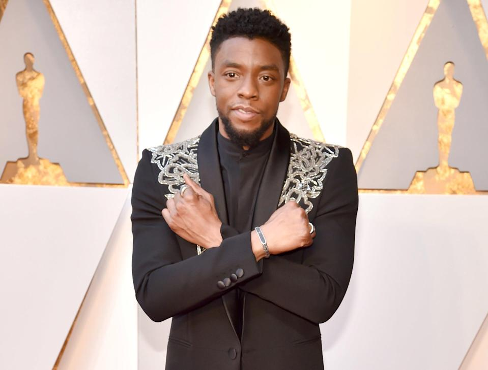 Chadwick gives the Wakanda Forever sign