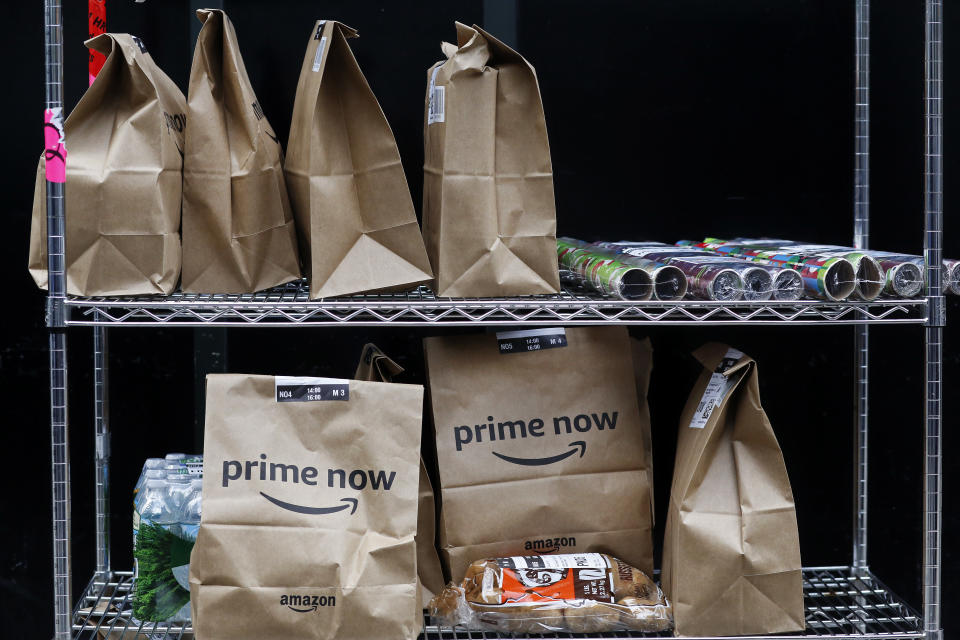 In this Wednesday, Dec. 20, 2017, photo, Amazon Prime Now bags are ready for delivery, at the Amazon warehouse in New York. (AP Photo/Mark Lennihan)