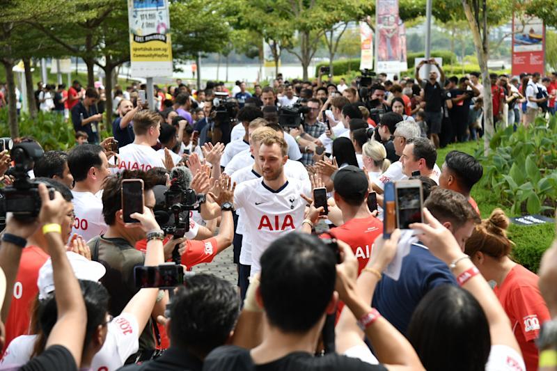 Tottenham Hotspur players acknowledge their fans during a sponsor's event at the Kallang Wave Mall ahead of their International Champions Cup match. (PHOTO: AIA Singapore)