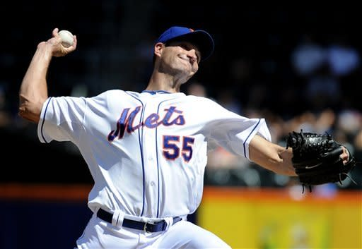 New York Mets starting pitcher Chris Young (55) throws against the Atlanta Braves in the first inning of a baseball game on Sunday, Sept. 9, 2012, at Citi Field in New York. (AP Photo/Kathy Kmonicek)