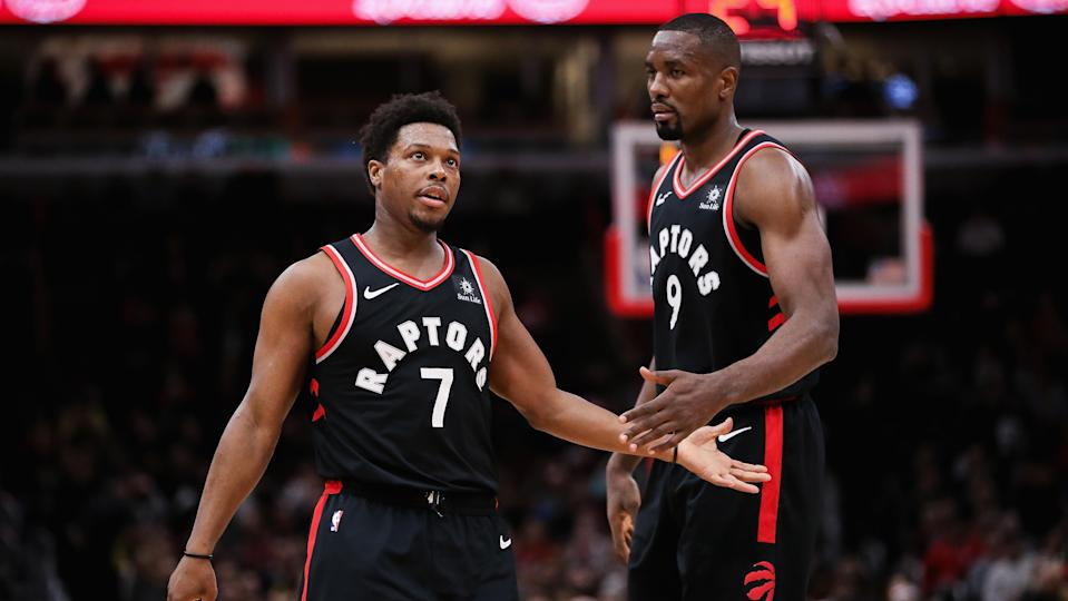 CHICAGO, ILLINOIS - MARCH 30:  Kyle Lowry #7 and Serge Ibaka #9 of the Toronto Raptors celebrate in the first quarter against the Chicago Bulls at the United Center on March 30, 2019 in Chicago, Illinois. NOTE TO USER: User expressly acknowledges and agrees that, by downloading and or using this photograph, User is consenting to the terms and conditions of the Getty Images License Agreement. (Photo by Dylan Buell/Getty Images)