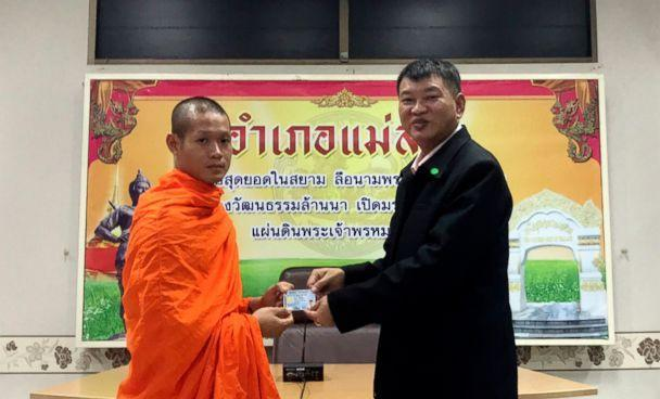 PHOTO: Former soccer coach Ekkapol Chantawong, left, receives an identity card denoting Thai citizenship from Somsak Kunkam, Sheriff of Mae Sai during a ceremony in Chiang Rai province, Thailand, Aug. 8, 20   18. (Chiang Rai Public Relations Office via AP)