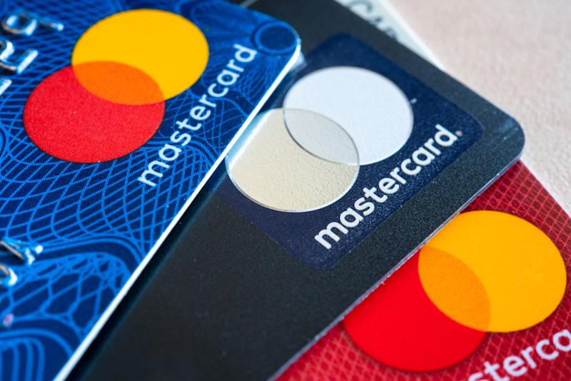In this photo illustration there are three Mastercard Credit