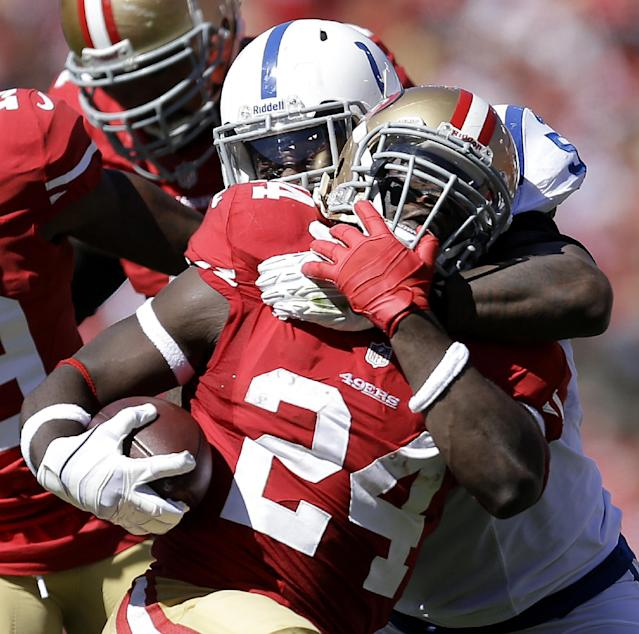 Indianapolis Colts inside linebacker Kelvin Sheppard, rear, tackles San Francisco 49ers running back Anthony Dixon (24) during the second quarter of an NFL football game in San Francisco, Sunday, Sept. 22, 2013. (AP Photo/Ben Margot)