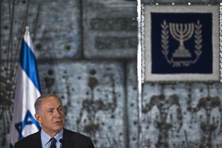 Israel's Prime Minister Netanyahu speaks before a group photo with the new Israeli government in Jerusalem