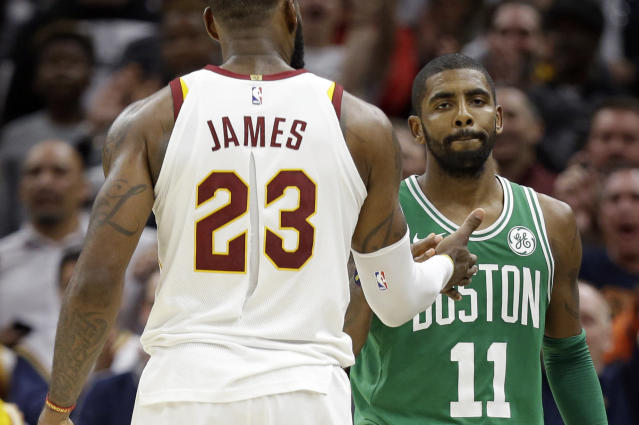 "<a class=""link rapid-noclick-resp"" href=""/nba/players/4840/"" data-ylk=""slk:Kyrie Irving"">Kyrie Irving</a> and <a class=""link rapid-noclick-resp"" href=""/nba/players/3704/"" data-ylk=""slk:LeBron James"">LeBron James</a> go their separate ways. (AP)"