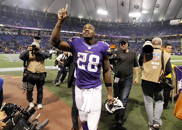 Minnesota Vikings running back Adrian Peterson reacts as he walks off the field after an NFL football game against the Washington Redskins, Thursday, Nov. 7, 2013, in Minneapolis. The Vikings won 34-27. (AP Photo/Ann Heisenfelt)