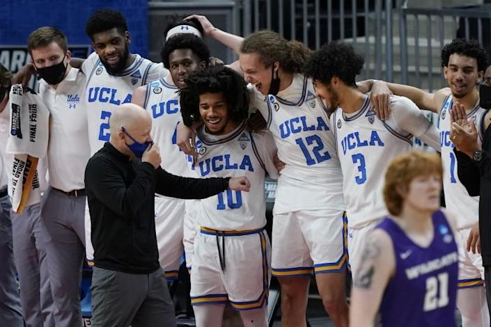 UCLA head coach Mick Cronin jokes with players in the final moments of their 67-47 win over Abilene Christian.