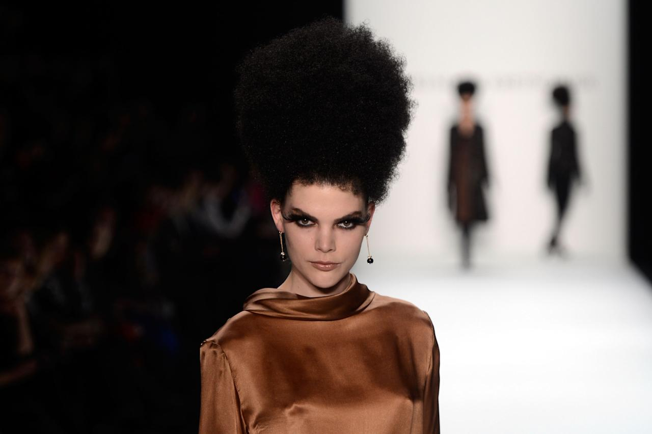 BERLIN, GERMANY - JANUARY 17:  A model walks the runway at Guido Maria Kretschmer Autumn/Winter 2013/14 fashion show during Mercedes-Benz Fashion Week Berlin at Brandenburg Gate on January 17, 2013 in Berlin, Germany.  (Photo by Frazer Harrison/Getty Images for Mercedes-Benz)