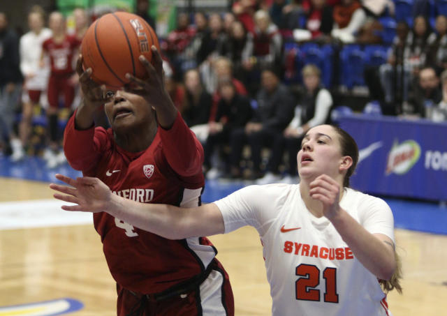 Stanford's Nadia Fingall holds on to the ball as Syracuse's Emily Engstler tries to steal it during the first half of an NCAA college basketball game Friday, Nov. 29 2019, in Victoria, British Columbia. (Chad Hipolito/The Canadian Press via AP)