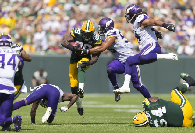 <p>Green Bay Packers running back Ty Montgomery (88) leaps over a defender as Minnesota Vikings linebacker Anthony Barr (55) and linebacker Eric Kendricks (54) chase during the second quarter at Lambeau Field. Mandatory Credit: Jeff Hanisch-USA TODAY Sports </p>