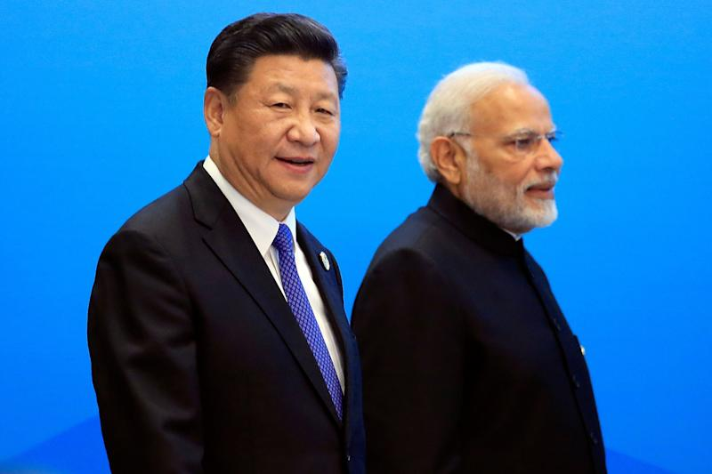 China's President Xi Jinping and India's Prime Minister Narendra Modi arrive for a signing ceremony during the Shanghai Cooperation Organization (SCO) summit in Qingdao, Shandong Province, China June 10, 2018. REUTERS/Aly Song (Photo: Aly Song / Reuters)