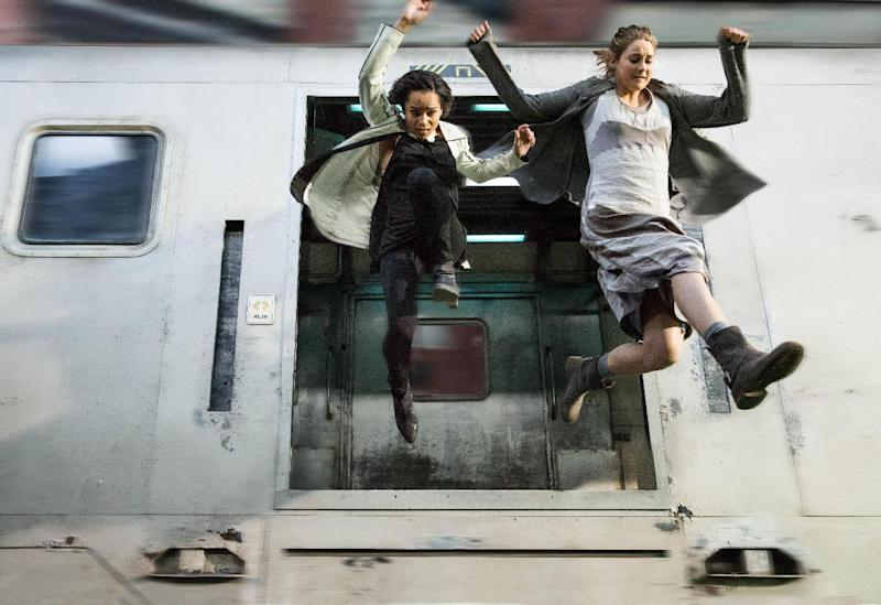 """This photo released by Summit Entertainment, LLC shows Zoe Kravitz, left, as Christina and Shailene Woodley as Beatrice """"Tris"""" Prior, in the film, """"Divergent."""" The movie releases Friday, March 21, 2014. (AP Photo/Summit Entertainment, Jaap Buitendijk)"""