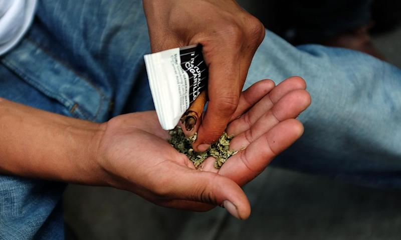 A man prepares to smoke spice