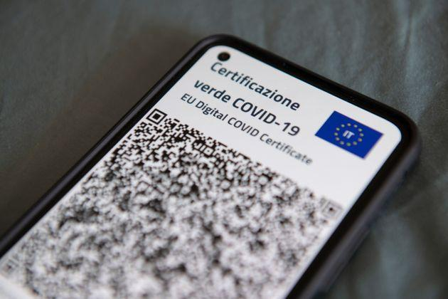TURIN, ITALY - JUNE 30: A close-up view of Italy's Covid-19 Green Pass for post-vaccine travel on a smartphone on June 30, 2021 in Turin, Italy. The digital health certificate, or Green Pass, was officially launched by Italian Prime Minister Draghi, allowing people to access certain events and facilities in Italy as well as travel domestically and abroad. (Photo by Stefano Guidi/Getty Images) (Photo: Stefano Guidi via Getty Images)