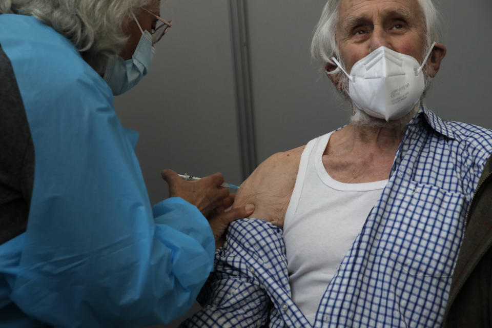 A man receives Pfizer's COVID-19 vaccine at a vaccination site in Paris, Saturday, March 6, 2021. The government plans to inoculate 10 million citizens by mid-April, 20 million by mid-May and a total of 30 million, or two-thirds of the adults by summer. (AP Photo/Christophe Ena)
