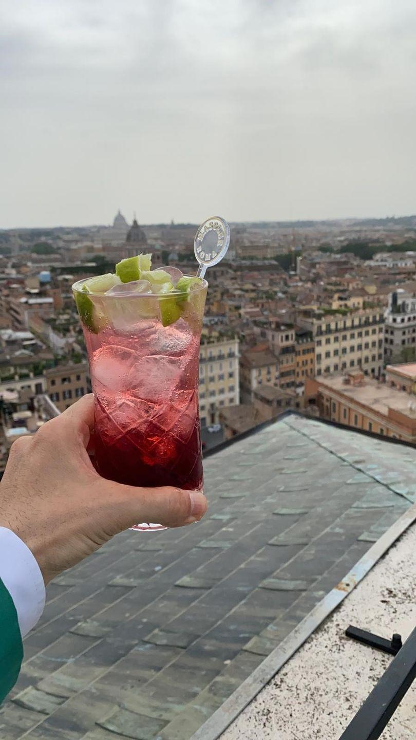 """<p>Served at Rome's iconic <a href=""""https://www.hotelhasslerroma.com/"""" rel=""""nofollow noopener"""" target=""""_blank"""" data-ylk=""""slk:Hotel Hassler"""" class=""""link rapid-noclick-resp"""">Hotel Hassler</a>, this is a truly Italian cocktail in both color and ingredients. Campari, soda, and lime represent the colors of the Italian flag. </p><p><strong>Ingredients:</strong></p><p>Ice cubes</p><p>1 ⅓ ounces bitter Campari</p><p>2 ounces soda water</p><p>⅓ ounces sugar cane syrup</p><p>⅓ ounces fresh lime juice</p><p>Lime wedges and pink peppercorns, for garnish</p><p><strong>Directions:</strong></p><p>Combine first five ingredients in a cocktail shaker, shake, and pour into a tall cocktail glass. Garnish with lime wedges and pink peppercorns.</p>"""