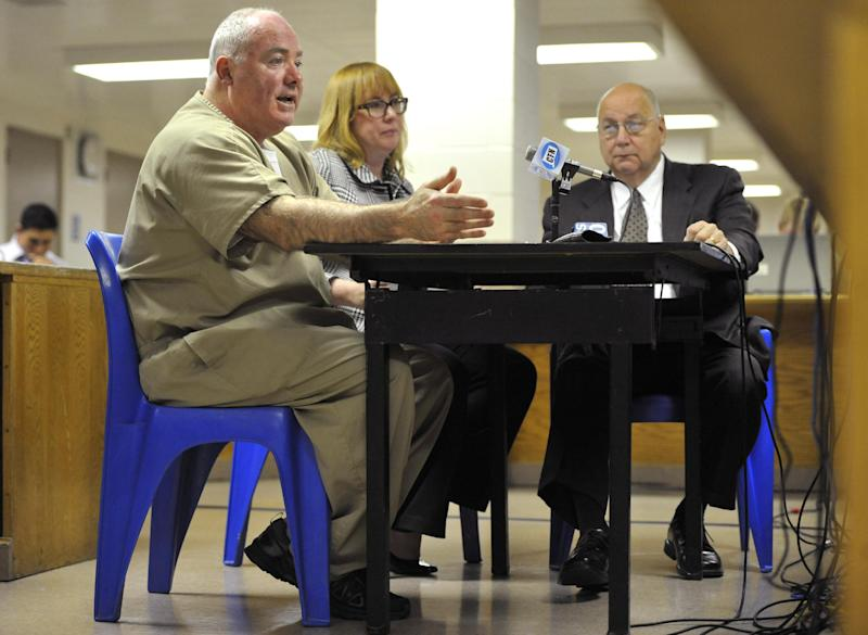 Michael Skakel, left, addresses a parole board with his attorneys Hope Seeley, center, and Hubert Santos, right, at his side during a parole hearing at McDougall-Walker Correctional Institution in Suffield, Conn., Wednesday, Oct. 24, 2012. Parole officials denied Skakel's first bid for parole since he was convicted a decade ago of killing his neighbor in 1975. Skakel is serving 20 years to life for fatally beating Martha Moxley with a golf club in Greenwich when they were 15-year-old neighbors. (AP Photo/Jessica Hill, Pool)