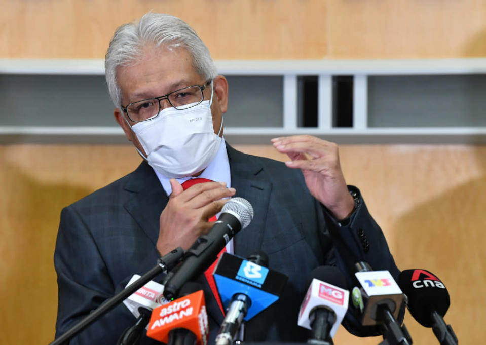 Home Minister Datuk Seri Hamzah Zainudin speaks to the media after co-chairing the Joint Committee Meeting on Management of Foreign Workers with Human Resources Minister Datuk Seri M. Saravanan in Putrajaya, April 22, 2021. — Bernama pic