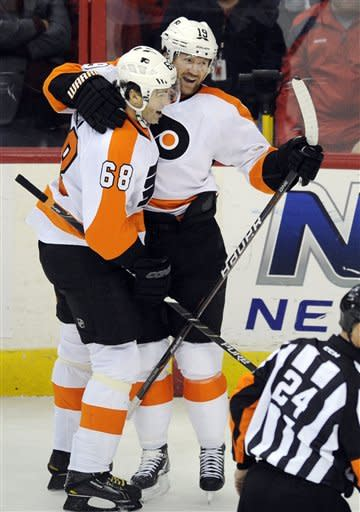 Philadelphia Flyers left wing Scott Hartnell (19) celebrates his goal with teammate Jaromir Jagr (68), of the Czech Republic, during the first period of an NHL hockey game against the Washington Capitals, Tuesday, Dec. 13, 2011, in Washington. (AP Photo/Nick Wass)