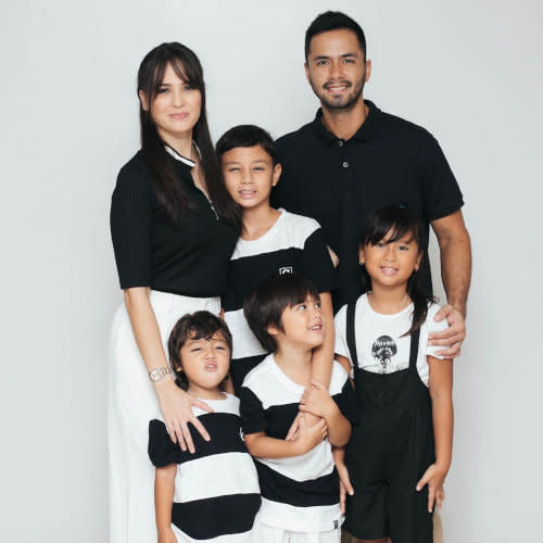 The couple with their children; daughter Ondrea and sons Kristian (Kiel), Kaleb, and Marvic.