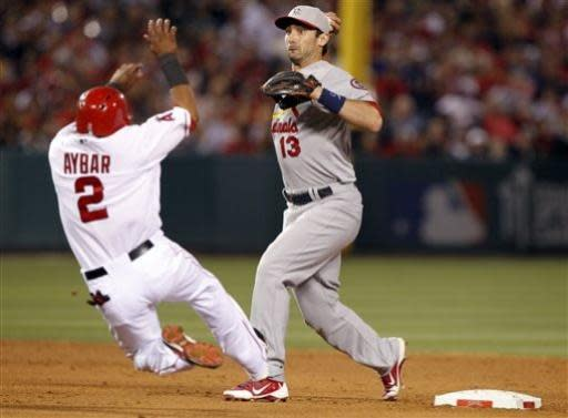 St. Louis Cardinals second baseman Matt Carpenter (13) turns two over Los Angeles Angels' Erick Aybar for a double play in the eighth inning during a baseball game on Thursday, July 4, 2013, in Anaheim, Calif. (AP Photo/Alex Gallardo)