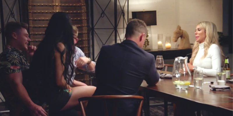 Vanessa sits on Chris' lap during MAFS dinner party