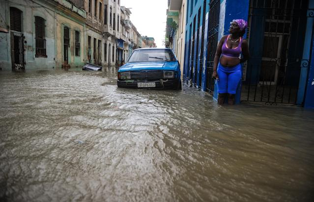<p>A Cuban stays in a flooded street in Havana, on Sept. 10, 2017. (Photo: Yamil Lage/AFP/Getty Images) </p>