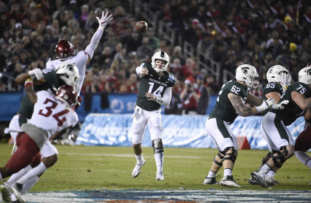 "Michigan State quarterback <a class=""link rapid-noclick-resp"" href=""/ncaaf/players/257176/"" data-ylk=""slk:Brian Lewerke"">Brian Lewerke</a> (14) threw 20 touchdowns in 2017. (AP Photo/Denis Poroy)"