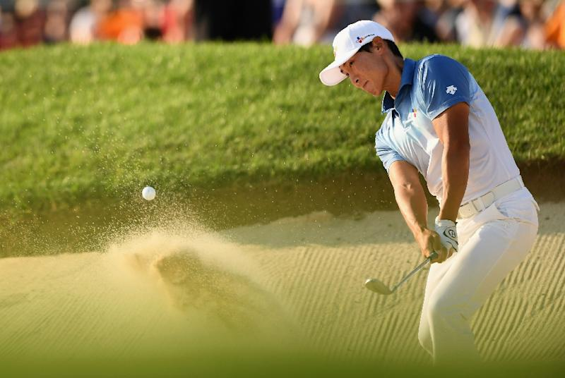 Kim Whee of South Korea plays a shot from a bunker on the 18th hole during the final round at the Canadian Open