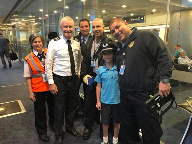 Luca and the American Airlines crew after he suffered anaphylaxis from eating a cashew. (Photo: Facebook/Francine Valerie Ingrassia)