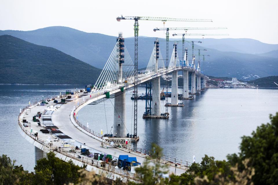 A view of the construction of Peljesac Bridge in Komarna, Croatia, Wednesday, July 28, 2021. European Union-funded Peljesac Bridge in southern Croatia that has been built by a Chinese state-owned company was opened late Wednesday. The bridge was designed to connect two swaths of Adriatic Sea coastline and passes over a small stretch of Bosnia's territory. (AP Photo)