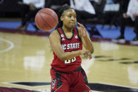 North Carolina State forward Kayla Jones (25) passes the ball during the first half of the team's NCAA college basketball game against South Carolina Thursday, Dec. 3, 2020, in Columbia, S.C. (AP Photo/Sean Rayford)